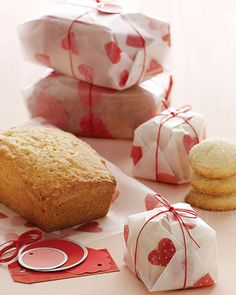 homemade goodies wrapped in festive valentine wrap and tied with twine. You can make this paper with wax paper and red tissue paper hearts.