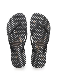 Havaianas Slim Logo Metallic Sandal Black/White  Price From: 40,43$CA  https://flopstore.ca/ca_french/new-arrivals/havaianas-slim-logo-metallic-sandal-black-white.html