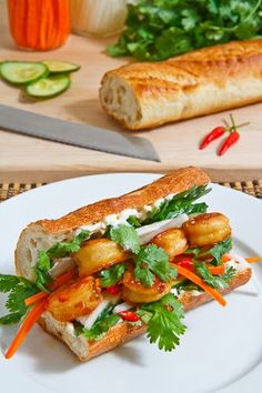 Vietnamese Caramel Shrimp Banh Mi-- A Bánh mì sandwich is a Vietnamese sandwich typically consisting of the pickles cucumbers cilantro chilies pâté mayonnaise and a meat all wrapped up in a baguette made from both wheat and rice flour. Vietnamese Cuisine, Vietnamese Recipes, Asian Recipes, Sandwiches, Lunch Snacks, Seafood Recipes, Cooking Recipes, Vietnamese Sandwich, Gastronomia