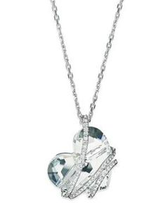 Fall in love with this pendant necklace from Swarovski. With a clear crystal heart wrapped in a crystal pave cage, this design becomes a romantic creation. Crafted in rhodium-plated mixed metal.