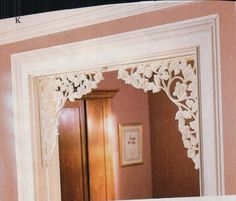 decorative corner brackets used in doorways to dress things up a bit can also be used as curtain rod holders with a overhead shelf for windows and doors if shaped properly...