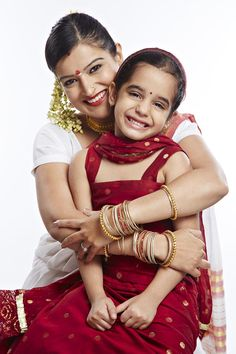 Portrait of a girl sitting with her mother and smiling Flower Girl Dresses, India, Stock Photos, Portrait, Wedding Dresses, Image, Fashion, Bridal Dresses, Moda