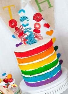 naked rainbow cake wedding cake with toppers