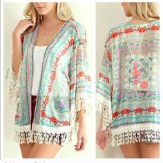 """Floral and Fringe Kimono Beautiful kimono! Size is large (10-12) Measurement laying flat: length: 31"""" Boutique Jackets & Coats Utility Jackets"""