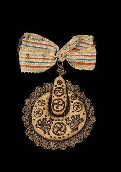 A nineteenth-century Russian hair accessory decorated with birds and swastikas (ancient symbols of good luck in Russian culture). (Metropolitan Museum of Art)