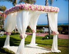 gorgeous wedding altar. Pink floral Mandap, white fabric mandap