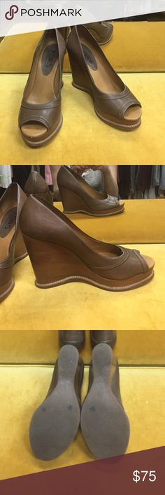 KORS Michael Kors brown peep toe wedge KORS Michael Kors (high end line) brown wedge peep toe platform leather shoes. Amazing condition only a few marks on bottom Michael Kors Shoes Wedges