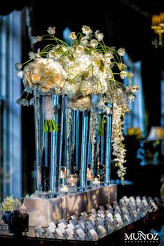 escort card table  or any table with bridal flowers in vases!! gorgeous