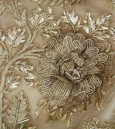 detail of beadwork on a 19th century dress | Threading Through Time