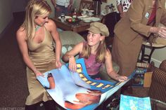 Britney meeting a fan in 2002 at the Starlight Foundation.