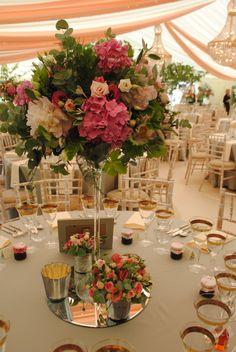 Pink wedding flower table arrangements in martini vases