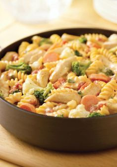 VELVEETA-Cheesy Chicken Rotini — What makes this recipe so rich and creamy? The way the cheese melts through all the pasta, veggies and chiles. All this and ready for the dinner table in just 40 minutes, too.