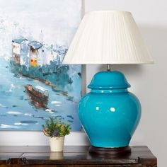 Yan table lamp on okl 179 v 400 retail made of base ceramic a bright chinese ceramic table lamp vividly lacquered in a sumptuous turquoise aloadofball Images