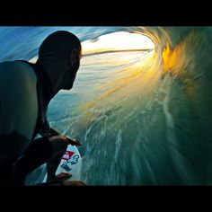 Kelly Slater  I have that pic as a wallpaper on my phone !