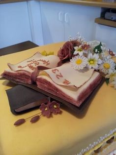 Bible and flowers on golden birthday cake - from the back