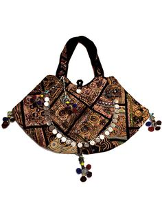 Puna Tote Bag. This spacious Gypsy05 Puna Tote Bag features an easy soft handle with a solid colored edging, paneling and interior. It has a zipper at the closing and small interior pocket. It is uniquely embroidered with recycled materials and fabrics that create a beautiful form of art. *Each bag is handmade and may vary in colors or patterns.