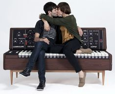 Yes, that's a MiniMoog synth couch you can actually buy from a Spanish design shop out of Barcelona called Woouf! This is a must have in a studio or synth geek's office. I'm thinking Robotspeak needs one in their shop.