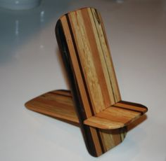 Cell phone stand.  Made from Walnut, Cherry, Maple and spalted maple.  The spalted maple actually came from a tree in my front yard my neighbor cut down for me.