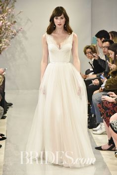 """Elise"" blush wedding dress with cap sleeves and a Chantilly lace bodice over a layered Spanish tulle skirt, by Theia"