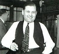 George Clarence Moran, better known as Bugs Moran, was a Chicago Prohibition-era gangster. On February 14, 1929, in an event which has become known as the Saint Valentine's Day Massacre, seven members of his gang were gunned down in a warehouse, supposedly on the orders of Moran's rival Al Capone. He has been credited with popularizing the act of driving by a rival's hangout and spraying it with gunfire, now referred to as a drive-by shooting.