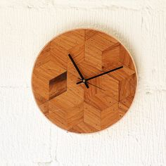 This unique wall clock is sleek and simple. The face pattern is made up from reclaimed oak, carefully cut and fitted into place to give a real mid-century modern look. Finished with natural leather around the edges this modern clock will fit perfectly onto any office wall or living room wall.  Each clocks finished with a scratch proof varnish. Please note that due to the natural qualities of wood, the wood grain will vary from the clock in the photo, but you can rest assure your clock will…