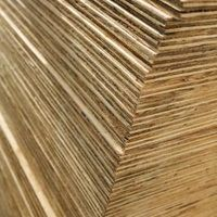 Plywood consists of multiple layers, or plies, of pressed wood that cling to each other and form a solid sheet. Although the surface of plywood is rough and not finished, it performs well as a base material for other woods, such as in furniture construction. One benefit of plywood is that is bends when exposed to moisture and pressure. This allows...
