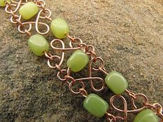 love this gold wire with that green, and the gorgeous swirls- this actually looks like something I could manage too!