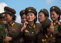 Smiling north korean female soldiers in tower of the juche idea, Pyongyang, North korea - Eric Lafforgue/Getty Images