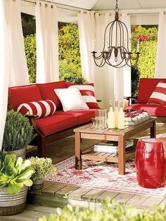 Outdoor room with curtains lining the exterior walls with windows. Great impact on a minimal budget.