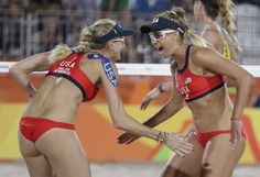 United States' Kerri Walsh Jennings, left, celebrates with her teammate April Ross, right, winning a point during a women's beach volleyball match against Australia at the 2016 Summer Olympics in Rio de Janeiro, Brazil, Sunday, Aug. 7, 2016. (AP Photo/Petr David Josek)