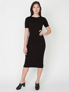 A figure-hugging mid-length ponte dress with short sleeves, high neckline, princess seams and back slit.