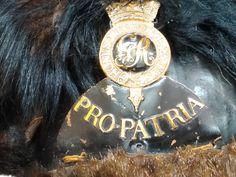 Close up of Tarleton hat badge