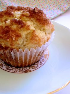Sour Cream Coffee Cake Muffins. Made with brown sugar, walnuts or pecans, cinnamon, butter, sugar, eggs, sour cream, vanilla flour, baking powder, baking soda, and salt.