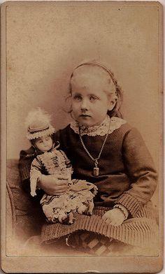 Girl With Doll 1875, looks like a wax head doll