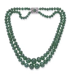 FROM THE ESTATE OF DORIS DUKE, A MAGNIFICENT TWO-STRAND EMERALD NECKLACE Each strand composed of sixty or sixty-one graduated emerald beads, joined by a single and old European-cut diamond pierced plaque clasp, centering upon a cabochon emerald, mounted in gold and silver, circa 1935.