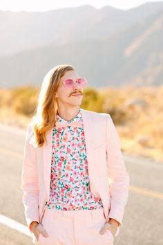 Colorful pink Palm Springs elopement with Sam Ushiro and Kyle of Aww Sam. Groom in floral shirt, pink suit, with cool long hair. Vibrant + unique wedding photography | Photo by Mary Costa Photography | www.marycostaweddings.com | #pinkwedding #palmsprings #palmspringselopement #awwsam #marycostaphoto Groom And Groomsmen Style, Groom Style, Semi Formal Wedding Attire, Modern Vintage Weddings, Parker Palm Springs, Modern Wedding Inspiration, Pink Suit, Los Angeles Wedding Photographer, Green Wedding Shoes
