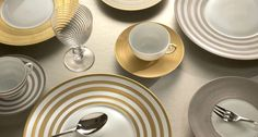 The Hemisphere dinnerware service is a best-selling signature pattern from JL Coquet. Limoges Porcelain Dinnerware | Harlequin London #hemisphere #gold #porcelain #tableware