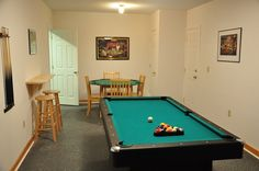 The pool table in the game room at Dreamers Ridge Cabin.