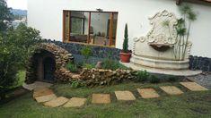 Fuente y cava para vinos extremo izq . Realizado en cemento con apariencia de piedra coralina.El Retiro (Ant)