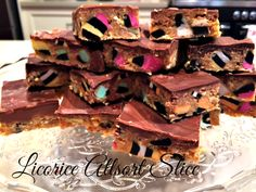 "Licorice Allsort Slice - this is a ""No-Bake"" (yippee) recipe that takes just literally minutes to put together. Chopped licorice allsorts, coconut, condensed milk, crushed biscuits, melted chocolate on top and you are done!"