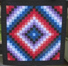 """Amish """"Sunshine and Shadows"""" Wall Hanging, circa 1990. Cross hatch and heart quilting at 6 stitches to the inch. Ronks, Lancaster County, PA."""