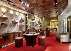 """To outfit the 650-square-foot space, Clough set up a studio at Louboutin's former office. """"We usually meet once a month, for one store or another,"""" Clough says. But this was a chance to immerse himself. """"You're walking into Christian's mind. There are treasures everywhere,"""" Clough marvels. """"It was great feeding off that collection."""" Yes, that is indeed how a taxidermic lemur wound up perched on a branch in the finished store."""