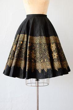 vintage 1950s black wool skirt with gold flocked design