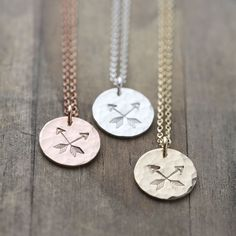 These hammered and hand stamped Crossed Arrows Friendship Necklaces feature a pair of crossed arrows, the symbol of friendship and love. Makes a lovely Valentine's Day gift for friends.