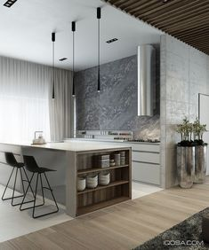 Sharp contrast defines the kitchen. Color, form, and materials change abruptly for an incredibly striking effect. Wood transitions to glossy white, concrete turns to marble, all wrapped up in a clean modernist package.
