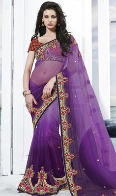 Elevate the elegant luster dressed in this bluish purple embroidered net saree. The ethnic dangler, floral patch, lace, resham and stones work with a clothing adds a sign of elegance statement for your look. Upon request we can make round front/back neck and short 6 inches sleeves regular sari blouse also. #ElegantPurpleShadesOfSaree