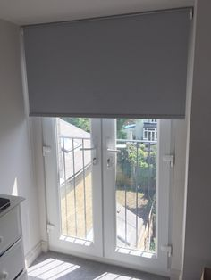 Blackout roller blind in flint colour to French doors for a house in Tooting. http://www.theblindshop.com