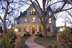 Queen Anne Victorian - I like Queen Anne's because of the rounded turrets.  This one is in Minnesota and has 8 bedrooms, 10,000 sq ft