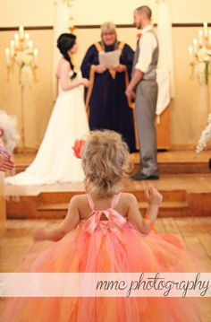 Flower girl watches bride and groom get married