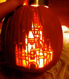 My Cinderella Castle jack-o-lantern! It took me HOURS to carve this last Halloween, but it was so worth it! It got third place in the BoardWalk Resort's pumpkin carving contest at Walt Disney World. :) #disney #disneyworld #waltdisneyworld #halloween
